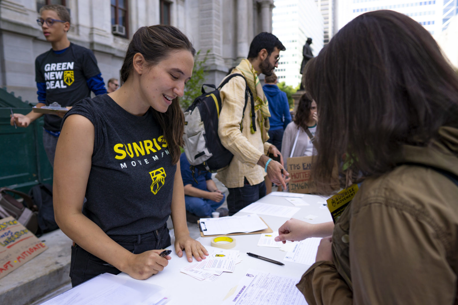 A Sunrise organizer stands by a table to register voters during the September 2019 Climate Strike.