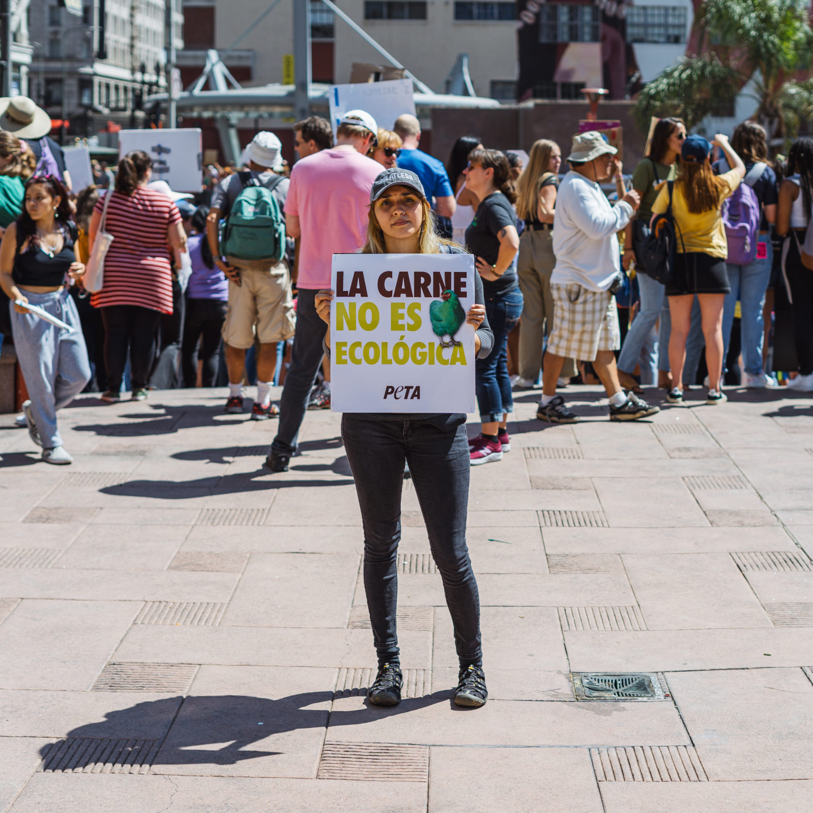 "An activist holds a sign saying ""La carne no es ecologica"" during the September 2019 Climate Strike."